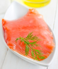 Fresh salmon in the white bowl