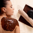 Spa therapy for young woman receiving cosmetic mask