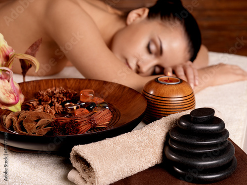 Photo: Young woman relax in beauty spa salon