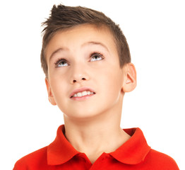 Portrait of young boy looking up