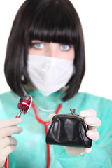 female doctor holding wallet