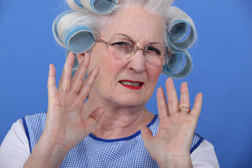Elder upset with curlers in her hair