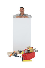 Carpenter with a blank board