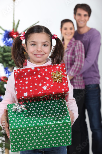 little girl receiving her Christmas presents