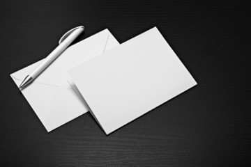 white blank envelope letter on dark desk