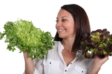 Woman with salad heads