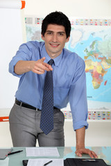 young business teacher pointing at you