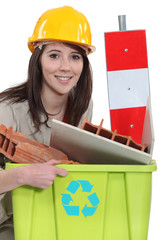 A female construction worker recycling scraps.