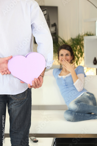 Man offering gift to girlfriend