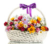 beautiful bouquet of bright  wildflowers in basket, isolated