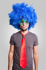 funny guy with blue wig green eyeglasses and red tie