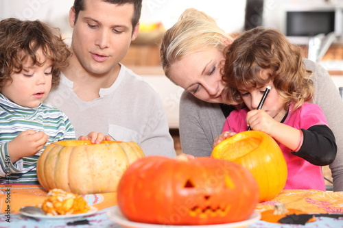 Family sculpting pumpkins