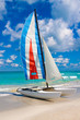 Colorful sailing boat on a tropical beach in Cuba