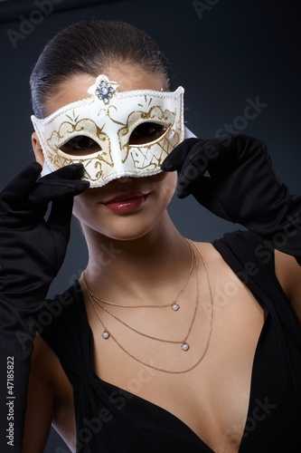 Woman in elegant carnival mask