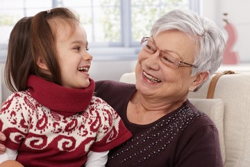 Grandmother and granddaughter laughing