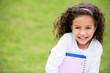 Happy schoolgirl outdoors