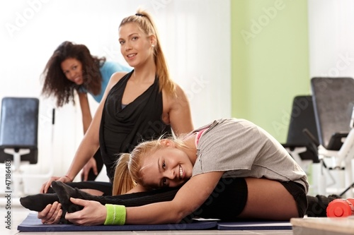 Flexible girls exercising at gym