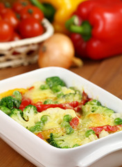 Vegetable casserole and fresh vegetables