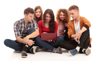 Group of students talking and holding notebooks