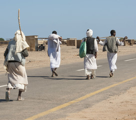 Egyptian bedouins walking down a road