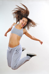 positive girl jumping and smiling