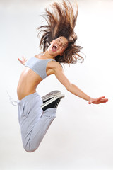 jumping instructor exercising in studio
