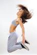 dynamic woman jumping in studio