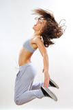 dynamic woman jumping in studio poster