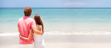 young beautiful couple on tropical bali beach.honeymoon