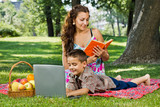 Mother reading a  book in park