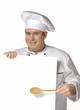 Cocinero chef sujetando una pancarta blanca.