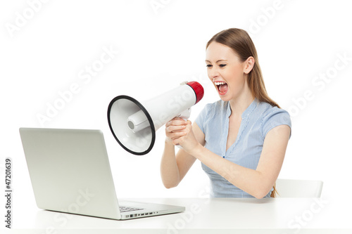 Businesswoman yelling at laptop