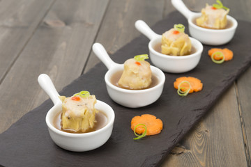 Chinese pork dumplings (shumai) with hot & sour soup.