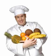 Cocinero chef sujetando frutas,ingredientes,alimentos.