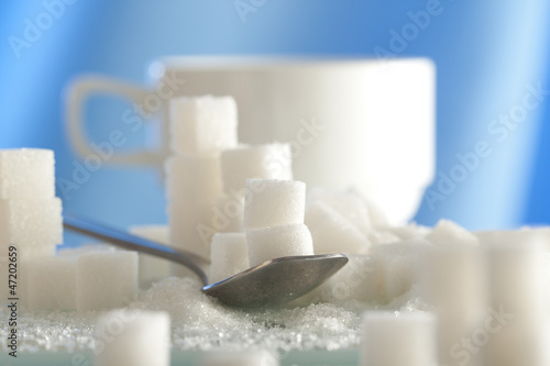 spoonful of sugar cubes with shallow depth of field