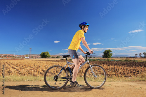 Biker in yellow shirt riding a bike