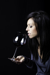 Beautiful girl smell a glass of wine color image