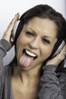 Beautiful girl listen music with headphone color image