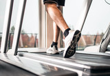 Fototapety Man running on a treadmill