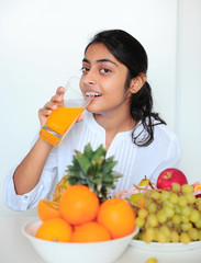 Beautiful girl holding fruits and a measure tape