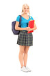 Female student standing with bag and holding books