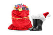 Santa accessories, pair of boots and bag full of presents