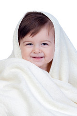 Happy baby covered with a towel