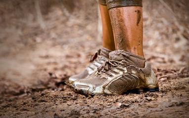 Mud race runner's muddy feet
