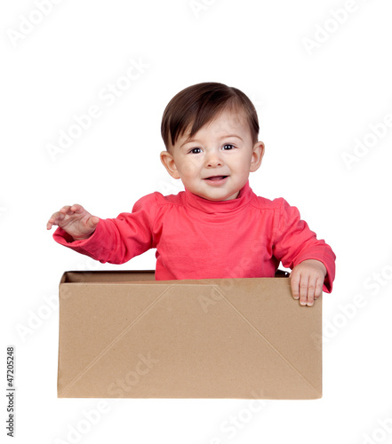 Adorable baby girl in a box