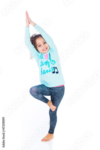 Cute young girl balancing