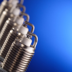 spark plug on blue background