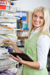 Young Blond Pharmacist Using Digital Tablet