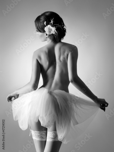 A young and sexy naked ballet dancer in white clothes © Maksim Šmeljov