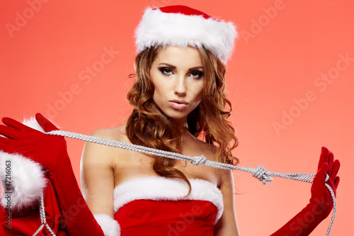 Portrait of beautiful sexy girl wearing santa claus clothes on r